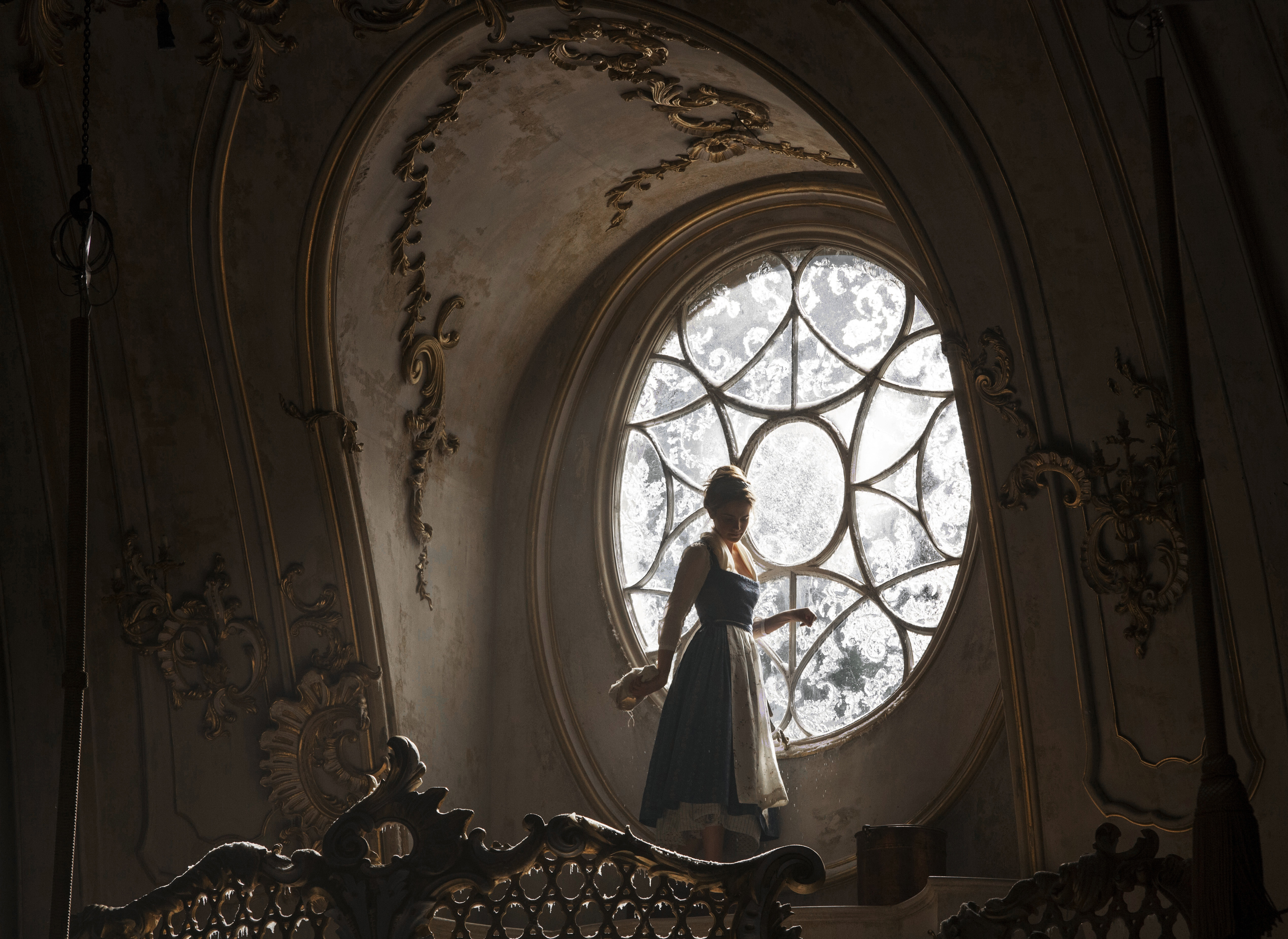 Belle (Emma Watson) in the ballroom of the Beast's castle in Disney's BEAUTY AND THE BEAST, a live-action adaptation of the studio's animated classic directed by Bill Condon which brings the story and characters audiences know and love to life.